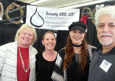 Deb, Jolene, Ivy and Tommy, Serenity sales team at a Holiday Gift Festival