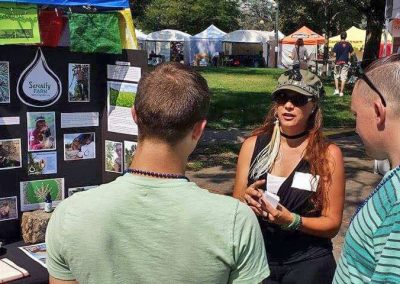 Ivy explaining the difference between HEMP and MARIJUANA in front of the State Capital at the Taste of Colorado